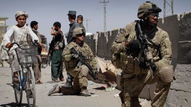 U.S. soldiers take position near the scene of an explosion in Kandahar south of Kabul, Afghanistan on Sunday, May 22, 2011. (AP / Allauddin Khan)