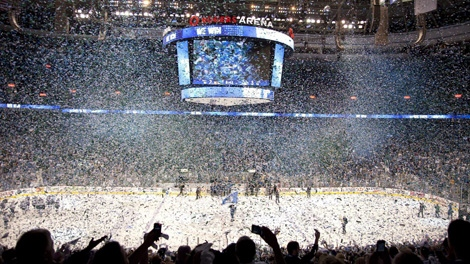 Confetti falls as fans celebrate the Vancouver Canucks double overtime win over the San Jose Sharks in game 5 of NHL Western Conference final Stanley Cup playoff hockey action in Vancouver, B.C., Tuesday, May 24, 2011. (CP/Jonathan Hayward)
