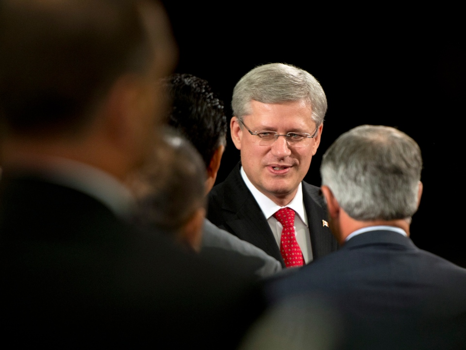 Prime Minister Stephen Harper greets guests in Toronto on Thursday August 29, 2013. (Frank Gunn / THE CANADIAN PRESS)