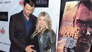 "Josh Duhamel, and his wife, Fergie, arrive on the red carpet for the premiere of ""Scenic Route"" at the Chinese 6 Theater on Tuesday, Aug. 20, 2013 in Los Angeles. (Katy Winn / Invision / AP)"