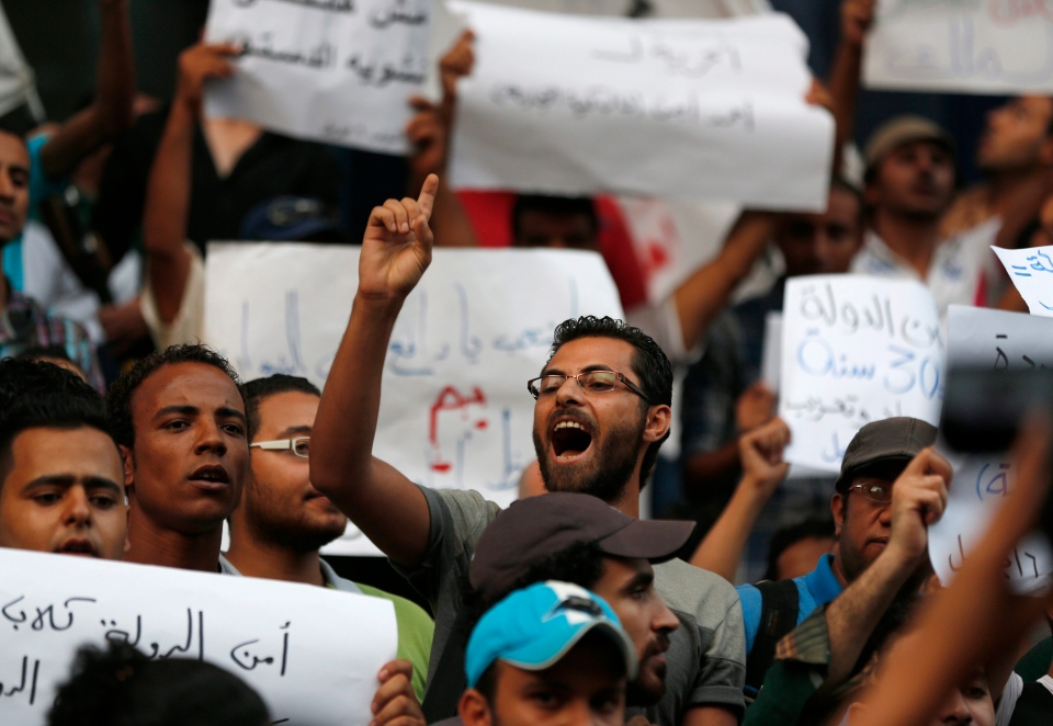 Demonstrators chant slogans during a protest against ousted President Hosni Mubarak's release from prison, in Cairo, Egypt, Wednesday, Aug. 28, 2013.  (AP / Lefteris Pitarakis)
