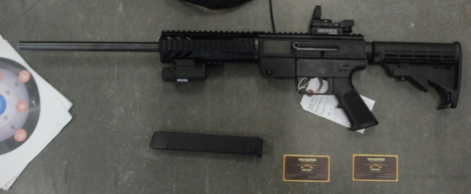 B.C.'s gang task force seized semi-automatic rifles with illegal, over-capacity magazines from a home in Tatla Lake on Aug. 23, 2013. (Handout)