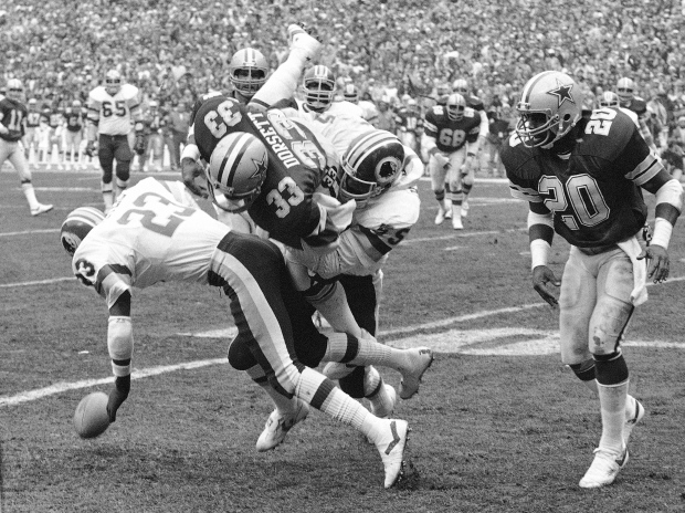 Tony Dorsett (33), NFL, concussion, 1983