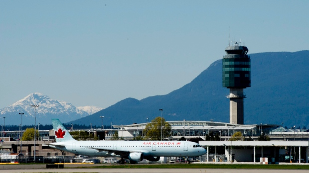 An Air Canada jet is seen on the runway of YVR international airport in Vancouver, B.C. Monday, May 6, 2013. (Jonathan Hayward / THE CANADIAN PRESS)