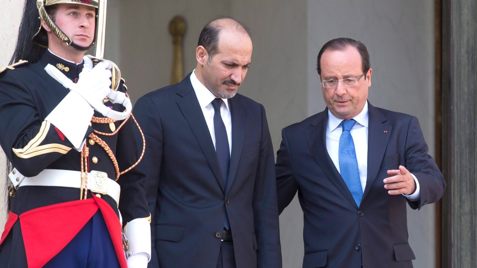 Head of the Syrian National Coalition, Ahmad al-Jarba, left, and France's President Francois Hollande, right, walk towards the media at the end of their meeting at the Elysee Palace, Thursday, Aug. 29, 2013. (AP / Michel Euler)