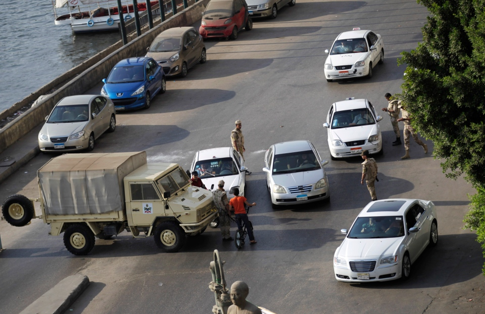 Egyptian security forces stop vehicles at a checkpoint in the Zamalek neighborhood in Cairo, Egypt, Friday, Aug. 30, 2013. (AP / Hiro Komae)