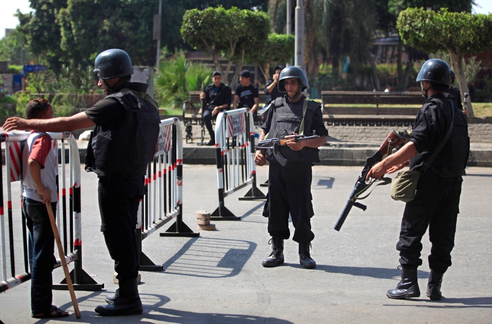 Egyptian police stand guard at an entrance to Sphinx Square in Cairo, Egypt, Friday, Aug. 30, 2013. (AP / Khalil Hamra)