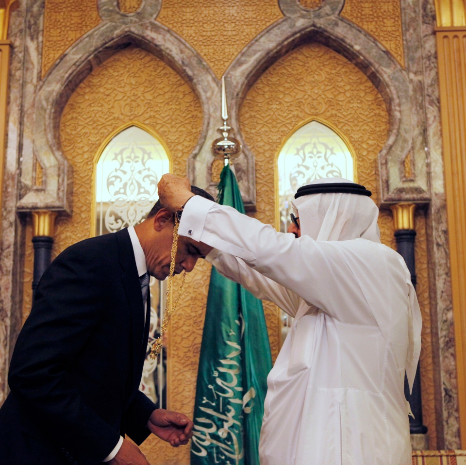 U.S. President Barack Obama receives a gift of a gold necklace called the King Abdul Aziz Order of Merit, the country's highest honor, from Saudi King Abdullah at the start of their bilateral meeting at the King's Farm in Riyadh, Saudi Arabia, June 3, 2009.  (AP / Gerald Herbert)