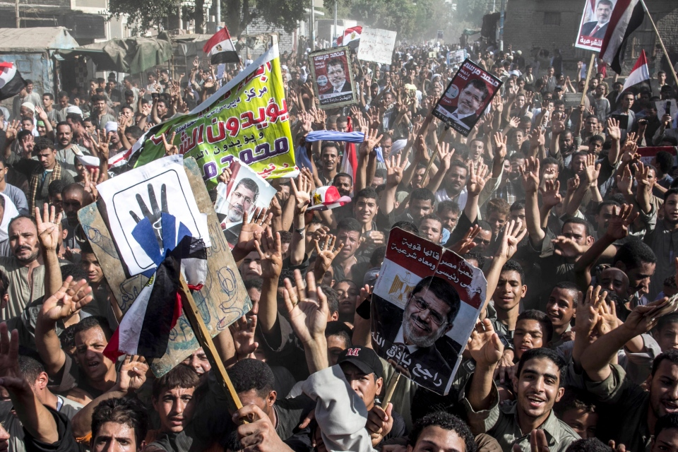 Supporters of Egypt's ousted President Mohammed Morsi chant slogans during a demonstration in Dalga Village, in upper Egypt, Friday, Aug. 30, 2013. (AP / Roger Anis, El Shorouk Newspaper)