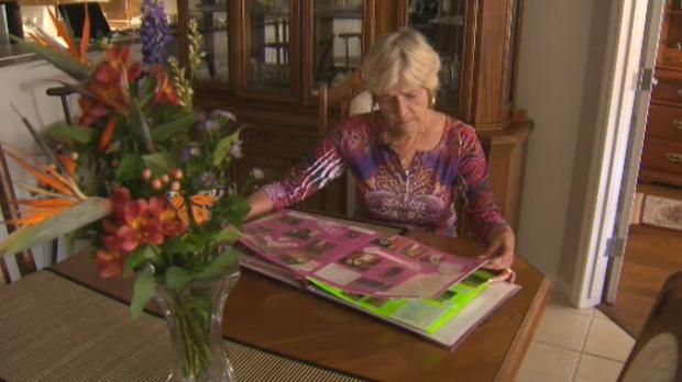 Sharon Geier reminisces with her wedding photo album