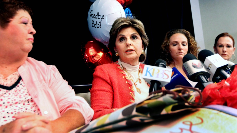 Attorney Gloria Allred speaks during a press conference with Katherine Ragazzino, second right, and sexual assault victims Peggy Shannon, left, and Michelle Tyler, right, at a hotel on Friday, Aug. 30, 2013, in San Diego. (AP / Sandy Huffaker)