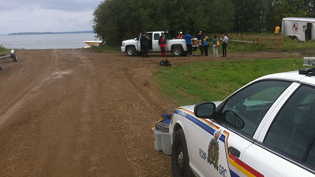 Officials are searching for a 69-year-old man who disappeared after a boat capsized on Lac la Biche Lake Friday night.