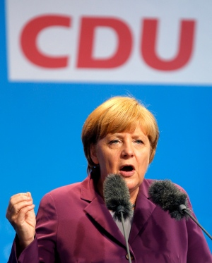 German Chancellor Angela Merkel speaks during an election campaign rally in Frankfurt, Germany, Friday, Aug.30, 2013. The German elections will be held on September 22. (AP Photo/Michael Probst)