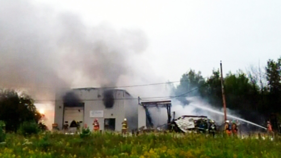 Firefighters work to put out a blaze at a Stewiacke, N.S. warehouse on Saturday, Aug. 31, 2013.