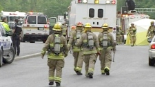 Fire officials arrive at Mother Teresa Catholic High School following an explosion on Thursday, May 26, 2011.