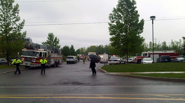 Emergency crews at the scene of an auto shop explosion at Mother Teresa High School in Ottawa on Thursday, May 26, 2011.