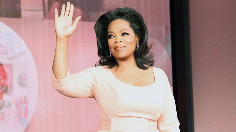 Oprah Winfrey waves as her show taped for the last time in Chicago, Tuesday, May 24, 2011. (Harpo Productions / George Burns)