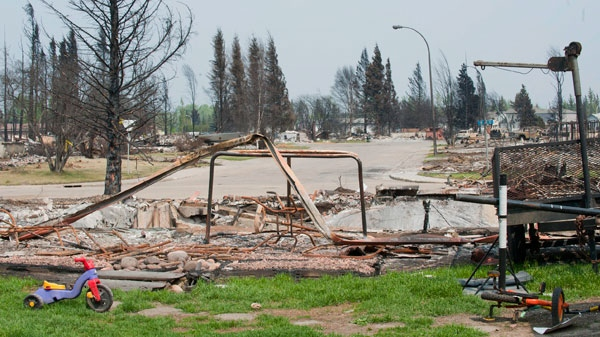 After a week and half away from their partially burnt out town, Slave Lake residents, whose homes were unscathed, had an opportunity to reoccupy their community on Friday, May 27, 2011. ( John Ulan / THE CANADIAN PRESS)
