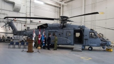 Defence Minister Peter MacKay inspects a new Canadian military Sikorsky CH-148 Cyclone helicopter at 12 Wing Shearwater in Halifax on Thursday May 26, 2011. (THE CANADIAN PRESS/Andrew Vaughan)