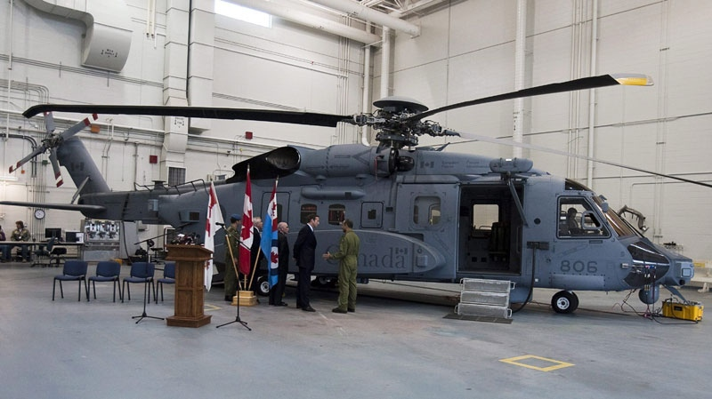 Defence Minister Peter MacKay inspects a new Canadian military Sikorsky CH-148 Cyclone helicopter at 12 Wing Shearwater in Halifax on Thursday May 26, 2011. (Andrew Vaughan / THE CANADIAN PRESS)
