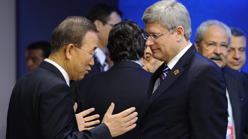 Prime Minister Stephen Harper, right, talks with United Nations Secretary-General Ban Ki-moon as they take part in a working session during the G8 Summit in Deauville, France on Friday, May 27, 2011. (Sean Kilpatrick / THE CANADIAN PRESS)