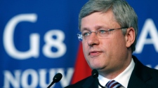 Prime Minister Stephen Harper speaks during a press conference at the G8 summit in Deauville, France, Friday, May 27, 2011. (AP / Markus Schreiber)