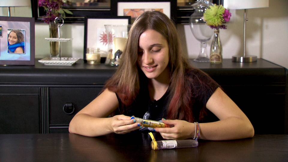 Zoe Santarelli-Gallo, who has been diagnosed with mild allergies to peanuts, tree nuts and egg whites, now carries an EpiPen.