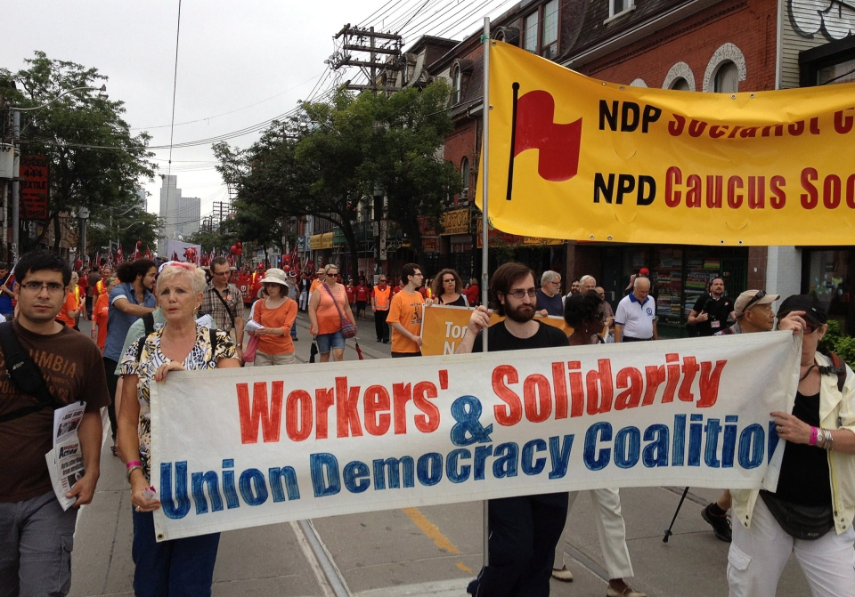 People take part in a Labour Day parade in Toronto, Monday, Sept.2, 2013. (Will Campbell / THE CANADIAN PRESS)