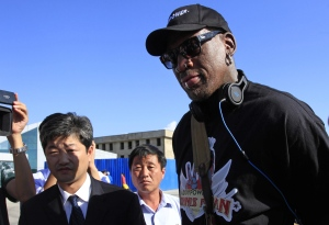 Former NBA star Dennis Rodman arrives at Pyongyang airport, North Korea, Tuesday, Sept. 3, 2013. (AP / Jon Chol Jin)