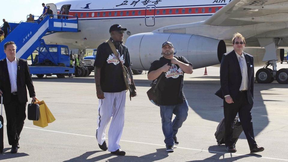 Former NBA star Dennis Rodman, third right, arrives at Pyongyang airport, North Korea, Tuesday, Sept. 3, 2013. (AP / Jon Chol Jin)