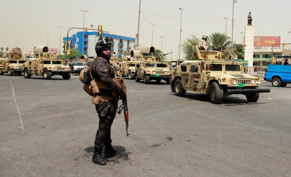 An Iraqi soldier stands guard in Baghdad, Iraq, in this 2013 file photo. (Hadi Mizban/AP Photo)