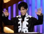 Prince accepts the award for outstanding male artist at the 38th NAACP Image Awards in Los Angeles, March 2, 2007. (AP / Chris Carlson)