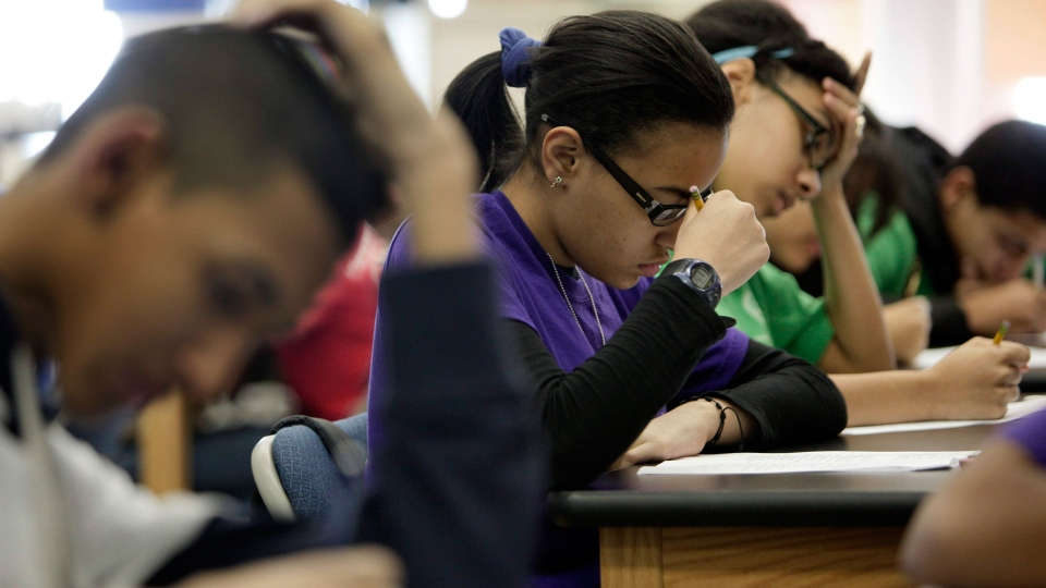 In a March 3, 2011 photo, students take a test during a Global History class at the Washington Heights Expeditionary Learning School, in New York. (AP / Richard Drew)