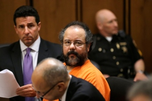 Ariel Castro sits in a Cleveland courtroom where he pleaded guilty to 937 counts of rape and kidnapping for holding three women captive in his home for a decade, July 26, 2013. (AP / Tony Dejak)