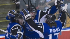 Saint John Sea Dogs defenceman Simon Despres, centre, celebrates his goal with teammates defenceman Pierre Durepos, left,and left wing Mike Thomas, right, against the Mississauga St. Michaels Majors during first period Memorial Cup championship action in Mississauga, Ont., on Sunday, May 29, 2011. (THE CANADIAN PRESS/Nathan Denette)