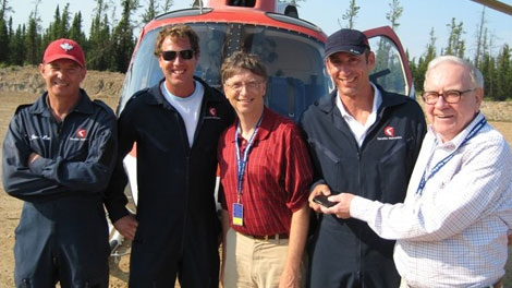 Helicopter pilot Jean-Luc Deba (far left) is shown in this photo with Bill Gates (centre) and Warren Buffet (far right) from 2008. Photo provided by family.