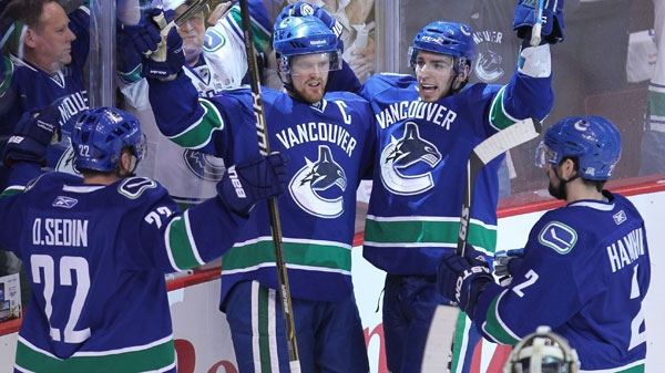 Vancouver Canucks' Alex Burrows, second right, celebrates his goal with teammates Daniel Sedin, of Sweden, (22) Henrik Sedin, of Sweden, second right, and Dan Hamhuis (2) as San Jose Sharks goaltender Antti Niemi, of Finland look on during the first period of game 5 of NHL Western Conference final Stanley Cup playoff hockey action in Vancouver, B.C., Tuesday, May 24, 2011. (Jonathan Hayward / THE CANADIAN PRESS)