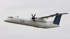 The first Porter Airlines plane does a fly past at the city centre airport in Toronto, Tuesday Aug. 29, 2006. (Adrian Wyld / THE CANADIAN PRESS)