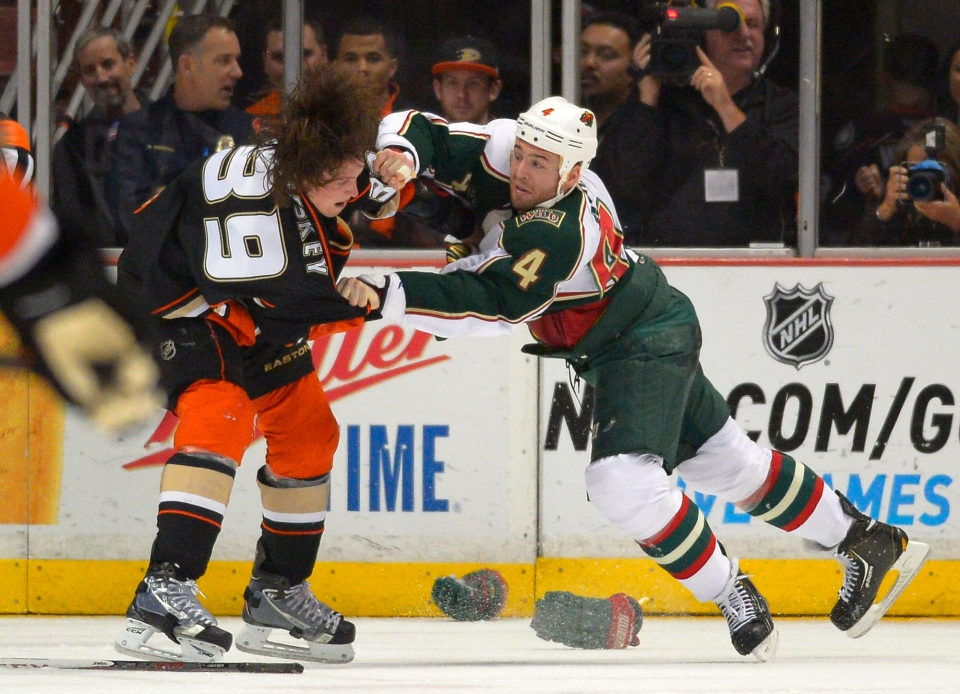 Anaheim Ducks left wing Matt Beleskey, left, and Minnesota Wild defenseman Clayton Stoner fight during the first period of an NHL hockey game in Anaheim on Friday, March 1, 2013. (AP / Mark J. Terrill)