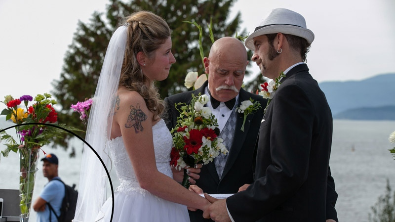 A suspected wedding thief was photographed and filmed scoping out a ceremony in Stanley Park on Sept. 1, 2013. (Butterfly Photography)