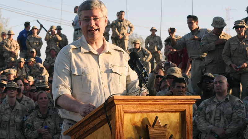 Canadian soldiers and civilians watch as Prime Minister Stephen Harper delivers a speech at New Canada House at Kandahar Air Field in Afghanistan on Monday, May 30, 2011. (Sean Kilpatrick / THE CANADIAN PRESS)