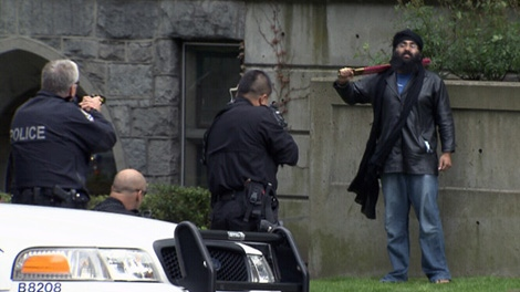 Vancouver police have subdued and arrested a man who was allegedly waving a sword near the intersection of Burrard and Georgia streets on Monday, May 30, 2011. (CTV)