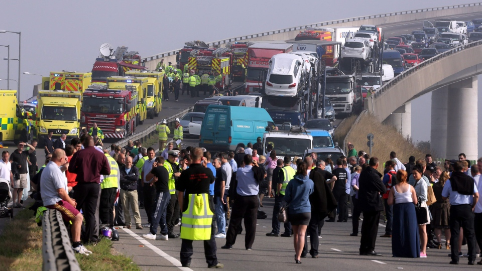 A general view of the scene on the London bound carriageway of the Sheppey Bridge Crossing near Sheerness in Kent, south England, following a multi vehicle collision earlier this morning, Thursday Sept. 5, 2013. (AP / Gareth Fuller, PA)