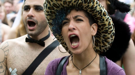 "A woman shouts during a ""Slut Walk"" demonstration in Montreal, Sunday, May 29, 2011, to highlight women's rights to dress and express themselves how they feel and not be at risk of attack. THE CANADIAN PRESS/Graham Hughes"