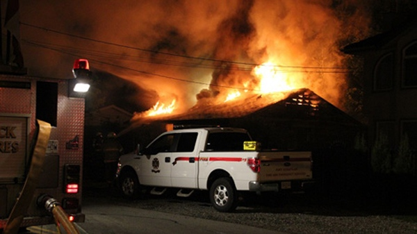 Fire crews battle three separate blazes in Port Coquitlam, B.C. overnight, Saturday, May 28, 2011.