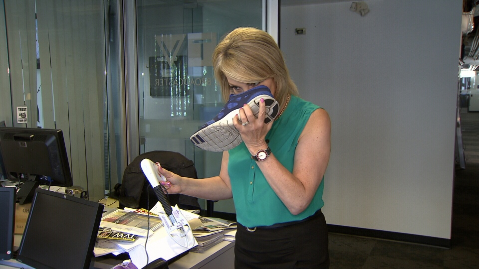 Consumer Reporter Lynda Steele smells sneaker to see if SteriShoe UV light device helps eliminate odours.