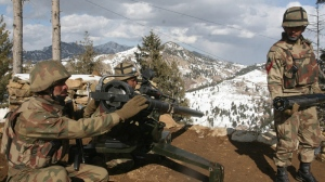 Pakistan army soldiers take positions in the Pakistani tribal area of Ditta Kheil in North Waziristan where the Pakistan army are fighting against militants and al Qaeda activists along the Afghanistan border on March 7, 2011. (AP / Mohammad Iqbal)