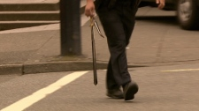 A Vancouver police officer carries a sword that was allegedly waved around by an erratic man in downtown Vancouver. May 30, 2011. (CTV)