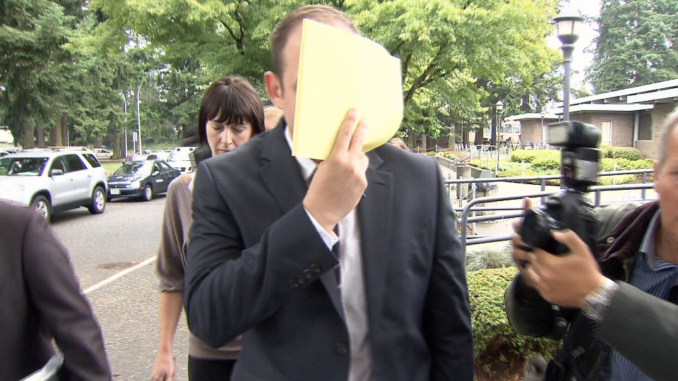 """Christopher David Long, 25, exits Abbotsford provincial court after a sentencing hearing covering his face with a legal pad on Friday, Sept. 6, 2013. The Abbotsford man pleaded guilty in May to charges that he hacked into """"Call Me Maybe"""" singer Carly Rae Jepsen's email and social media accounts. (CTV)"""