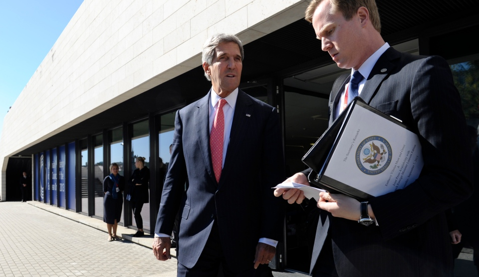 U.S. Secretary of State John Kerry, centre, with aide Jason Meininger as he leaves a meeting with European Union Ministers of Foreign Affairs at the National Gallery of Art in Vilnius, Lithuania, Saturday, Sept. 7, 2013. (AP / Susan Walsh)
